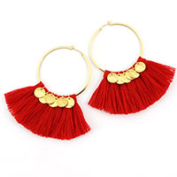 Homemade red pompom hoops with golden sequins