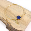 Lapis Lazuli interlayer and feather charm