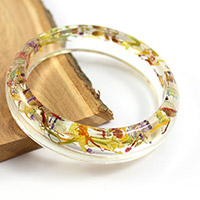 Resin bracelet and inclusion of dried flowers