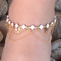 Gold tone ankle chain with enameled flowers