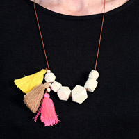 Necklace faceted wood beads and tassels