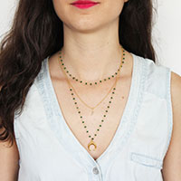 DIY jewelry Fancy multi-strand necklace with a beaded chain and a horn pendant