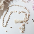 DIY Bohemian long necklace in cowrie shells
