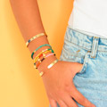 Stacking Elastic Bracelets in Gemstones and Metal Rings