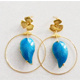 Gold earring hoops and turquoise leaf