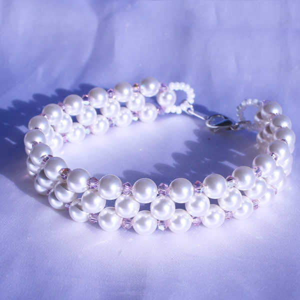 Pearly bracelet with Swarovski beads and bicones - Perles & Co