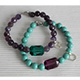 Emerald and faceted round bead bracelet